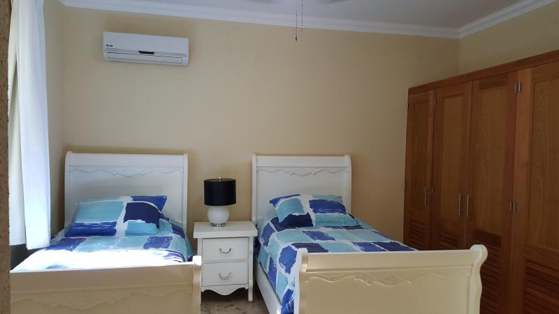 Second bedroom with private bathroom and cabinet