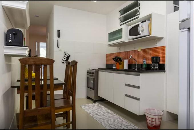 Fully-stocked kitchen for all your cooking needs, including filtered water and microwave oven.