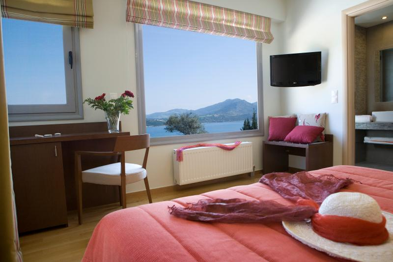 Bedroom with comfortable double bed amazing sea views and private batroom