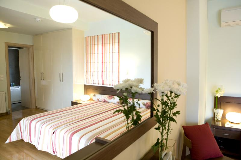 Bedroom with two comfortable single beds private bathroom and sea views