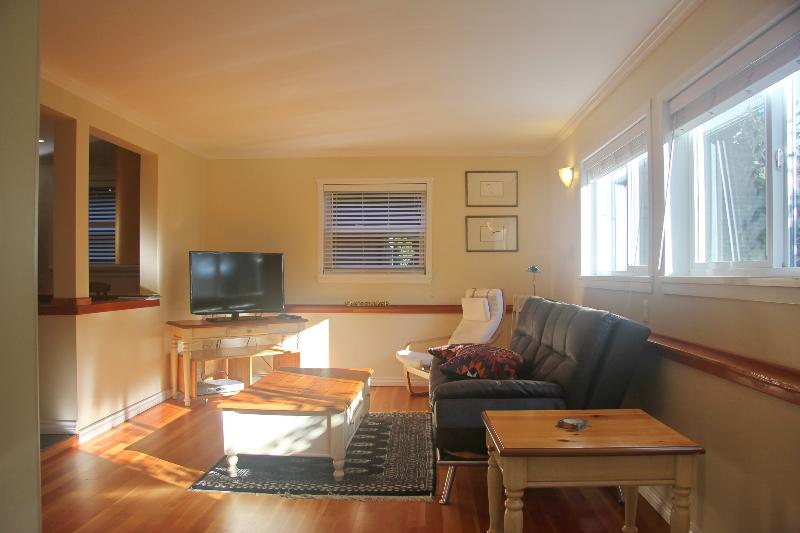 New fully furnished suite with bright living room & new HD TV