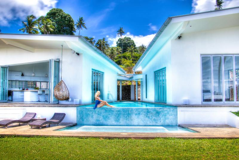 wrap around infinity edged pool accessible from entranceway, living and bedrooms with sun pool below
