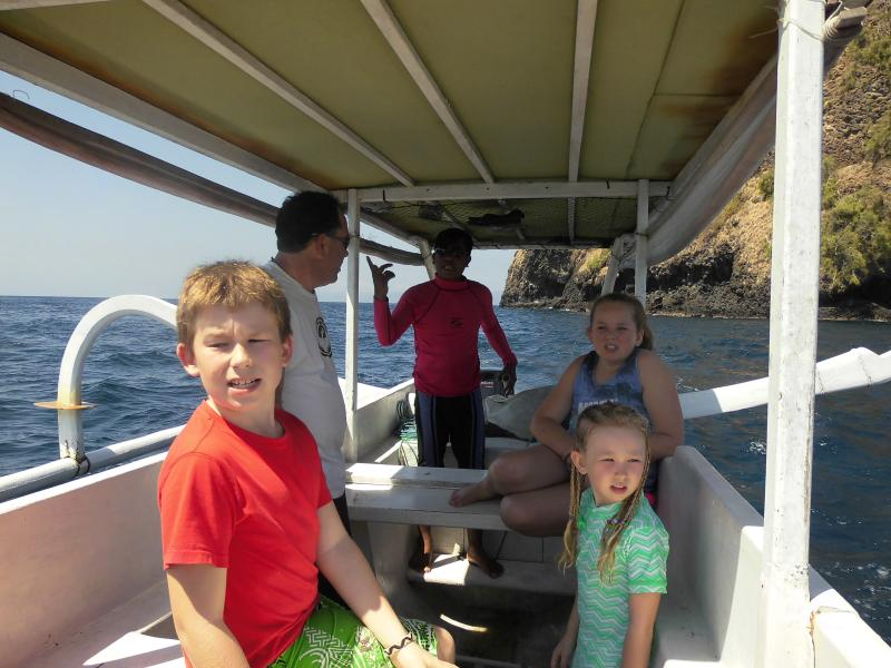 Take a local fishing boat to White Sand Beach,   snorkel, catch  a fish on the way, great day out.