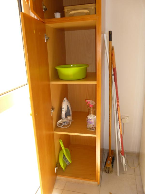 Kitchen Cupboard.First Aid Box,Iron,Clothes Rack.