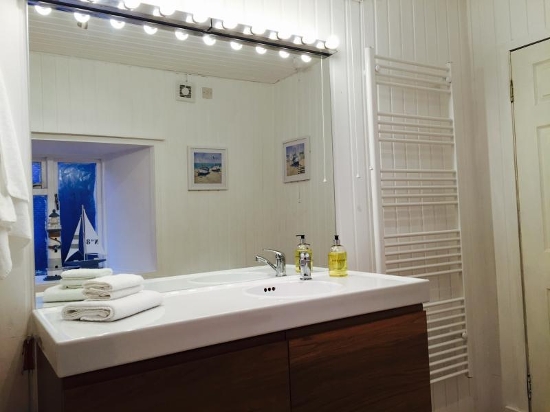 Modern bathrooms with heated towel rails, large 2 meter two person bath. Shower, vanity unit etc.