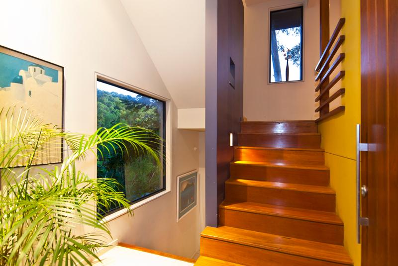 inside front door with stairs leading up to the lounge