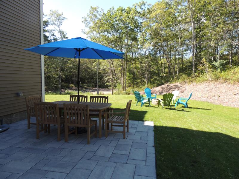 Back yard with patio and fire pit