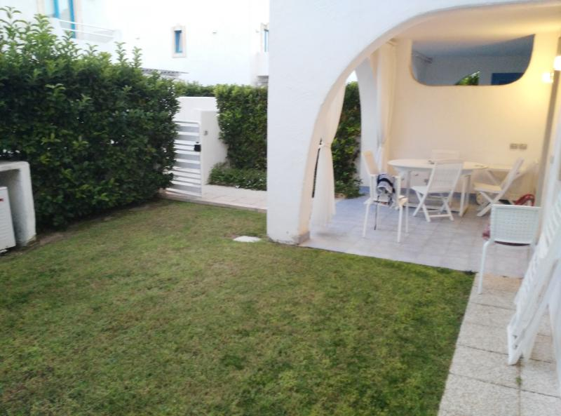 The outdoor dining area and private garden