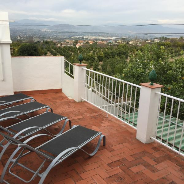 New sunbeds and view out over the Orange grove to the mountains
