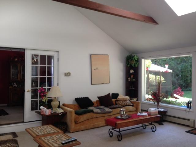 Family room with cathedral ceiling.