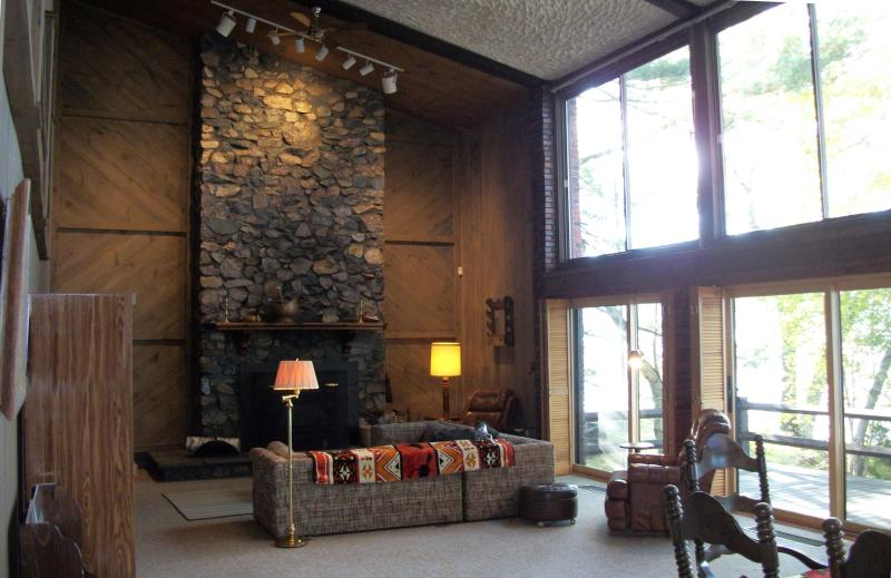 Magnificent fieldstone fireplace in great room.  All sliding glass doors open to the large deck.