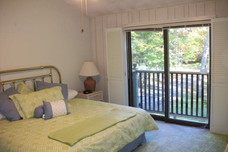 This upstairs bedroom has a queen bed.  All upstairs doors have shutters that close for privacy.