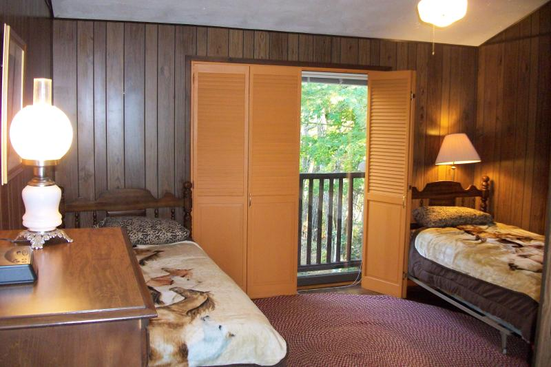 The Mustangs upstairs bedroom has two full size twin beds.  Adjust the shutters  as suits you.