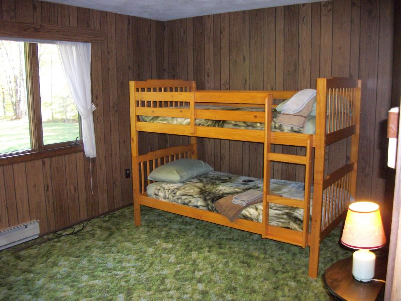 Beside 5 bedrooms is the bunk bed room.  All first floor sleep rooms have windows looking to forest.