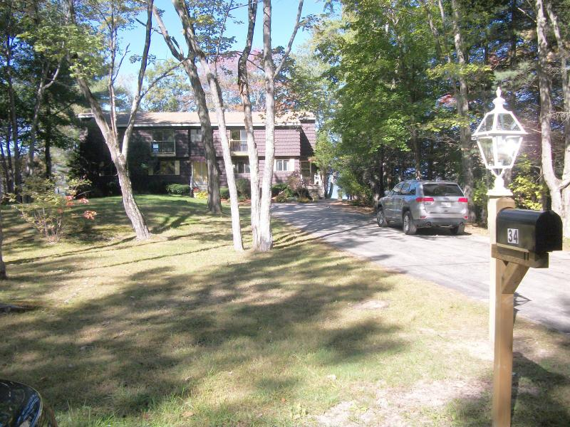 Long wide driveway provides ample parking and convenient access to Ossipee Lake House.