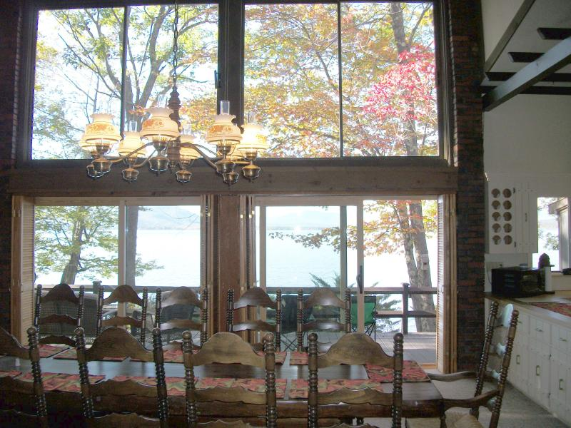 Furnishings include magnificent dining table that seats 12 positioned for marvelous views of lake.
