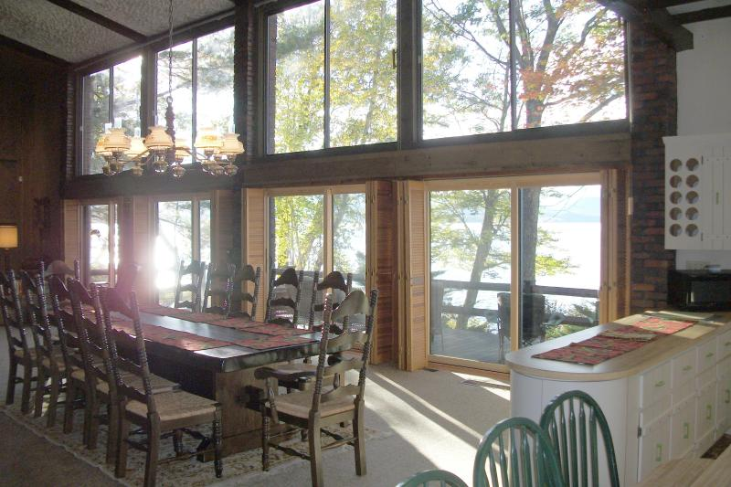Inside, looking out two stories of windows and sliding glass doors to the deck and lake.