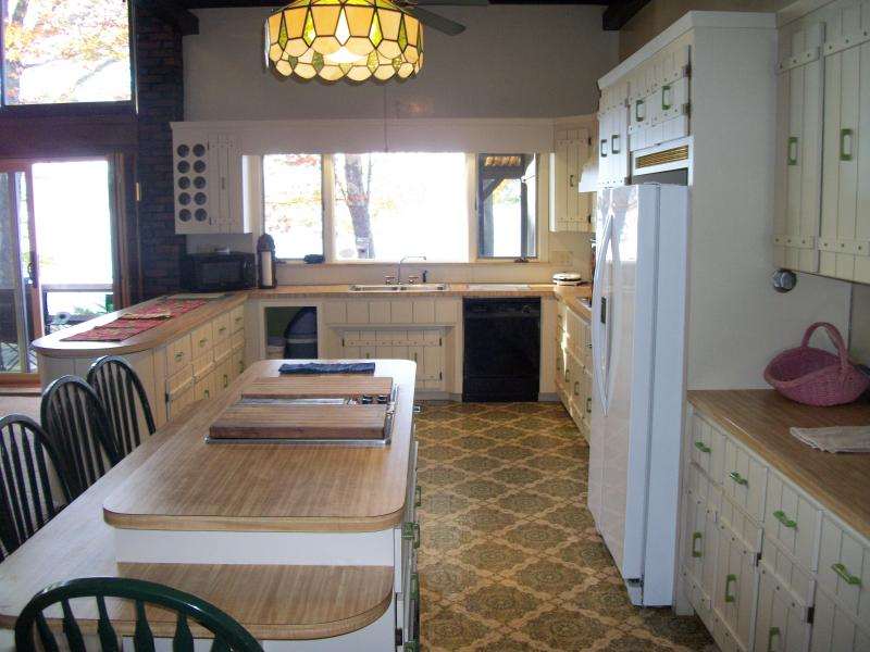 Kitchen looks out over lake and has counters for easy preparation and serving of memorable meals.