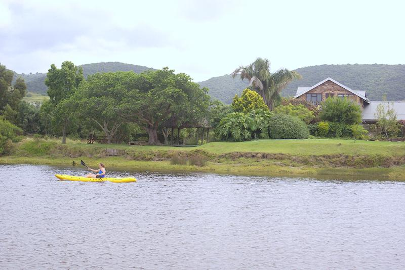 Guests  kayaking in front of the apartment