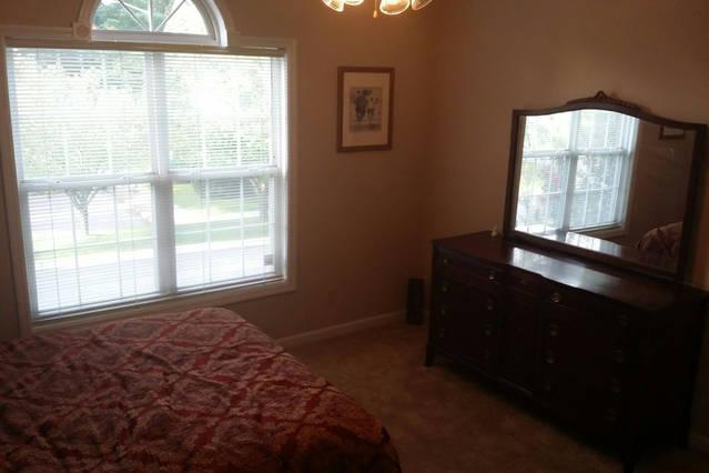 Guest Bedroom with Queen, dresser, walk in closet