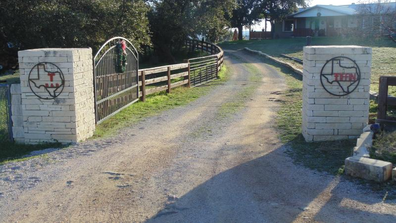 Entrance on highway 29  to our home and Texas T B n B.  Entrance to cabin is thru metal gate on left