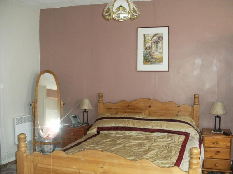 Master bedroom with double and single bed and direct access to bathroom.