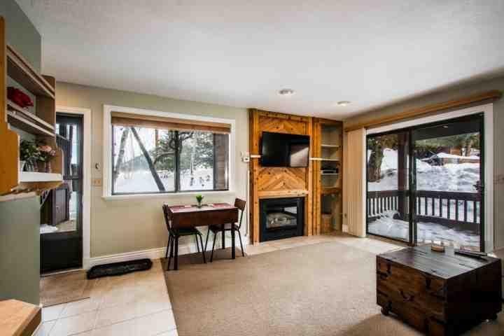 The living area is fully furnished with large living room furniture, which can second as a sleeper sofa, a gas fireplace and a 45' HDTV with entertain