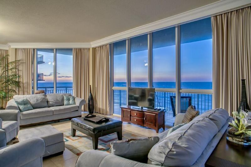 Stunning Ocean Front Kitchen/Dining/Living/Wet Bar Area that opens to the 75 foot balcony