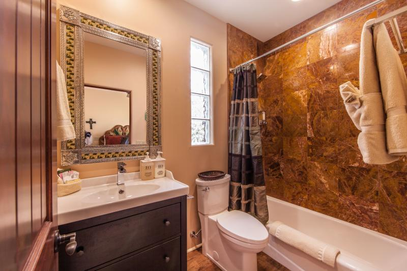 The 2nd bathroom has a shower tub or a walk in shower, depending on suite, commode, and 1 or 2 sinks