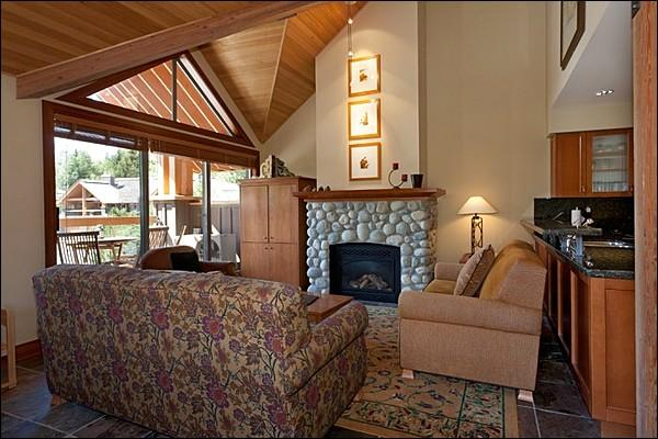Beautiful Inviting Living Area with Stone Fireplace