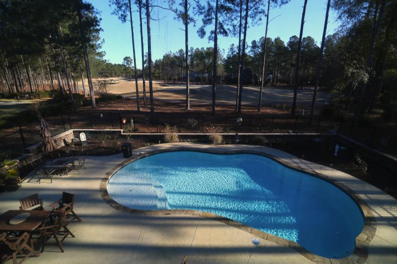 Custom inground pool overlooking 13th green of Cedar Creek Golf Course