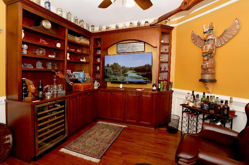 Man cave with 55' curved TV