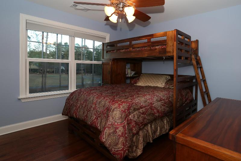 Full bed with twin bunk overlooking pool and golf course