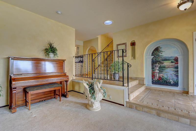 Welcome to West Coast Villa I. Our living room includes an upright piano rebuilt by the owners