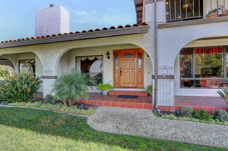 West Coast Villa I is built in a classic Mission style with terracotta tiles, arches and breezeways