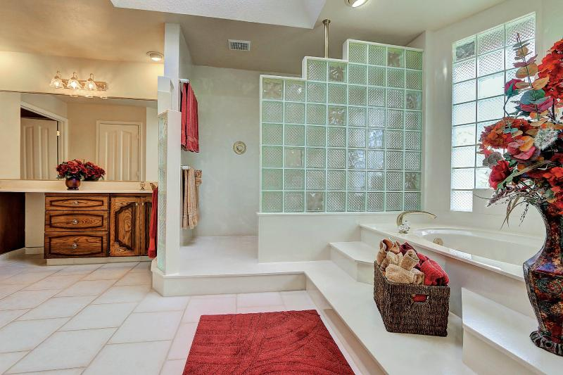 Bright and airy West Coast Villa I Master Bath with glass block windows, skylight, and soaker tub