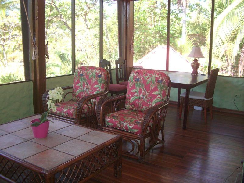 Screened veranda in Master Suite with seating and desk area