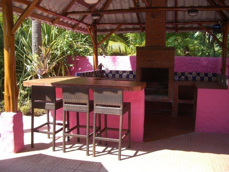 Rancho adjacent to the pool has a bar and charcoal barbeque
