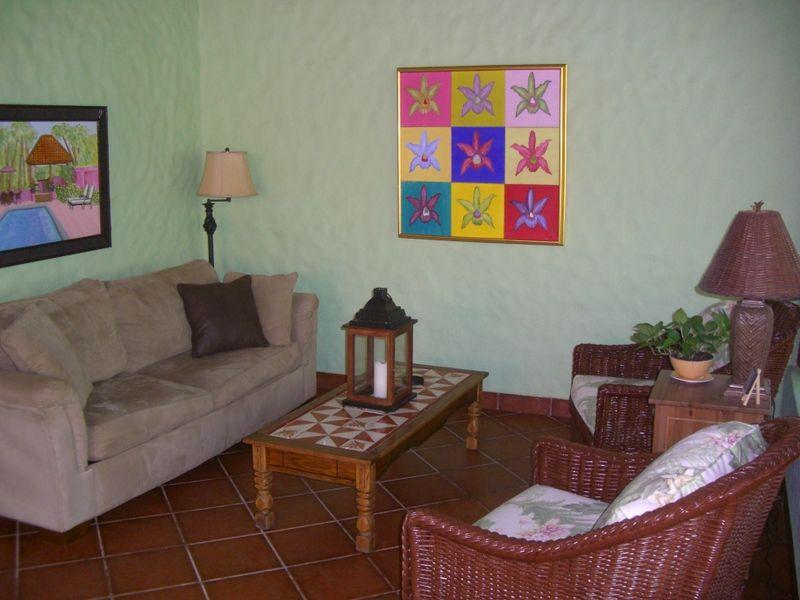 Living Room area provides ample seating. Original artwork graces the walls
