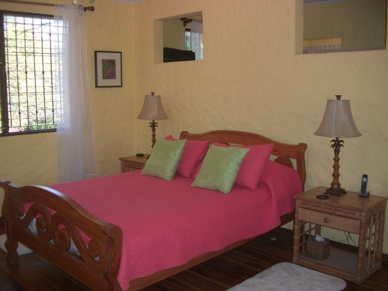 Master suite features queen bed, dressing area and bath, private veranda