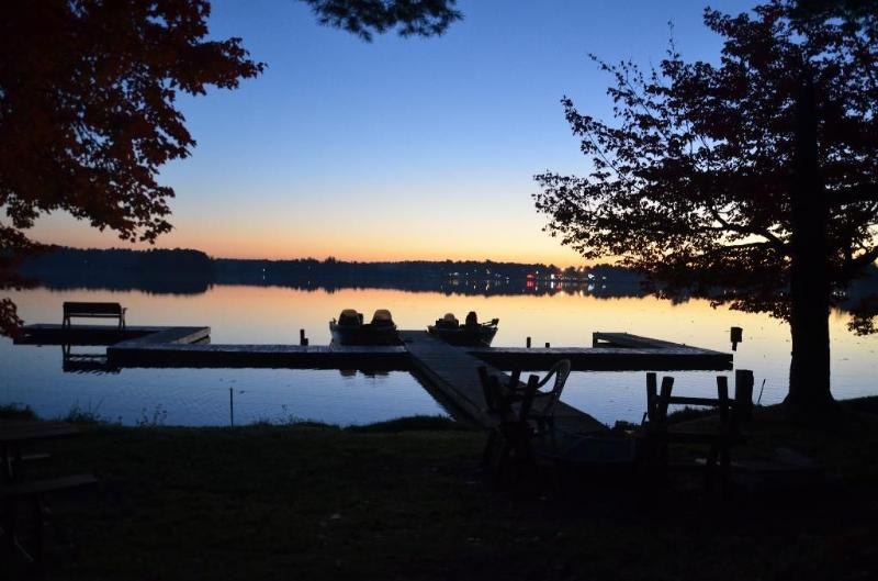 Enjoy the sunset from the fire pit by the boat dock. Cabin includes pier space for 1 watercraft.