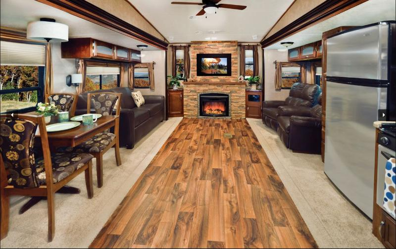 Living room with leather sofa, 2 recliners, massage chair, fireplace & 36' HDTV