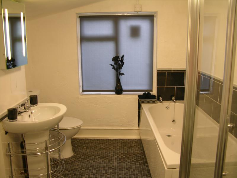 Bathroom showing full size bath and shower