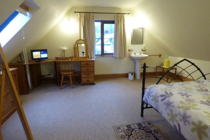 Bedroom 1 - double with washbasin & tv