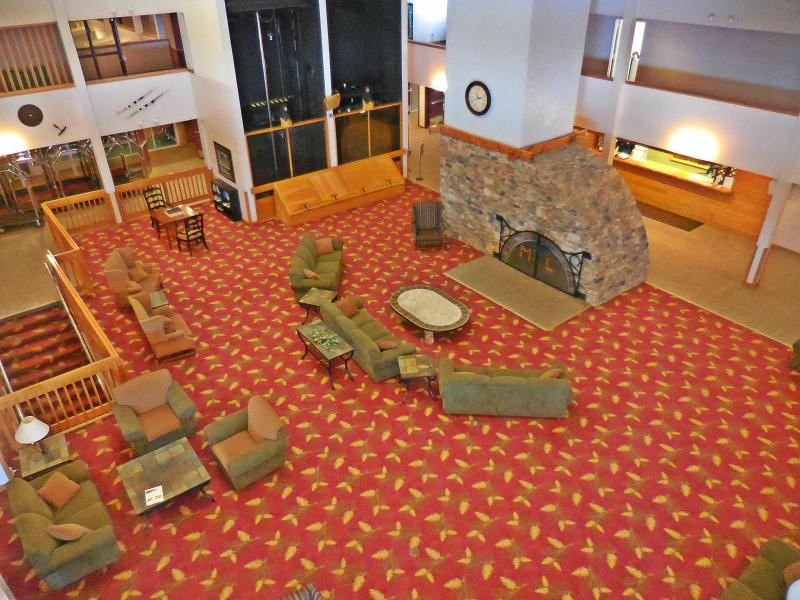 Large fireplace in cozy Mountain Lodge lobby