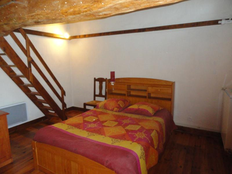 Pigeonnier bedroom with staircase to the mezzanine bedroom