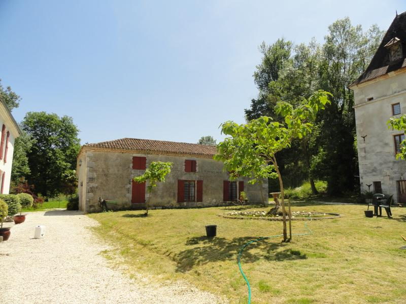 The three properties (Main house - left, Four a pain - centre, Pigeonnier - right).