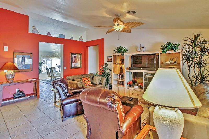 The high ceilings and decorative ceiling fans give the home a bright, cool feel