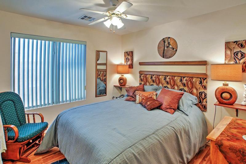 Bedroom 2 includes a cozy queen bed.