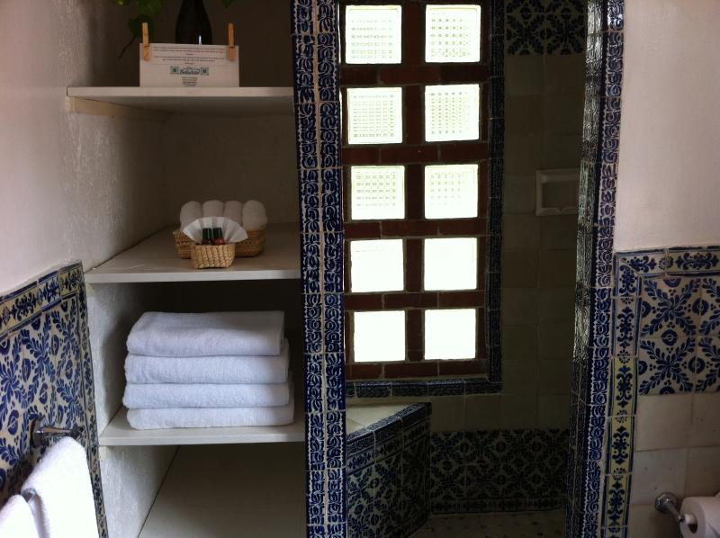 Talavera tile bathroom with hotel amenities of natural herbal shampoo, soaps and conditioner.